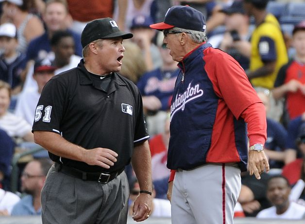 Davey Johnson argues with the ump before being thrown out.