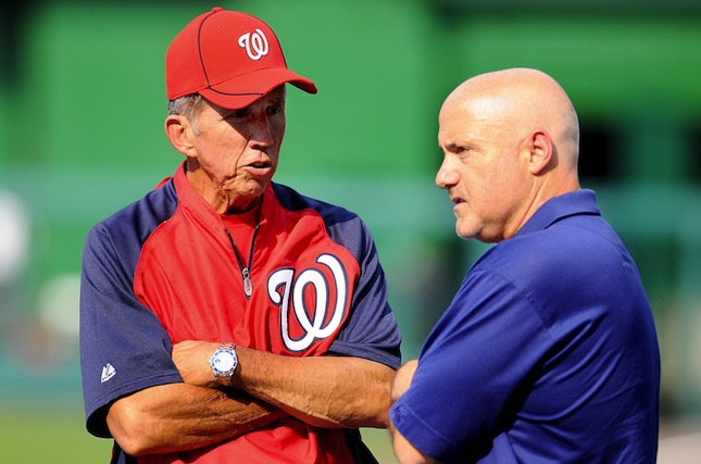 Davey Johnson talking to GM Mike Rizzo with his Rolex Submariner (Evan Habeeb-US PRESSWIRE)