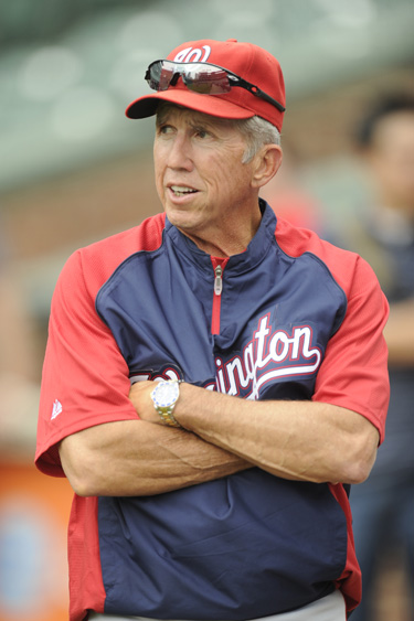 Davey Johnson watching batting practice with his Rolex Submariner on June 22. (Photo by Mitchell Layton/Getty Images)