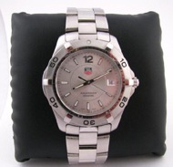 Men's Tag Heuer AquaRacer 300M stainless watch sapphire crystal date window at 3 O'clock